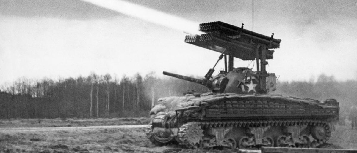 A rocket-firing Sherman tank, the Allies' latest secret weapon, is seen in action on the Western Front, on March 10,1945 , during the last months of World War II. The new weapon is being used to give close support to bridge-building engineers, and has dealt effectively with encircled enemy rearguards. (Photo: AFP/Getty Images)