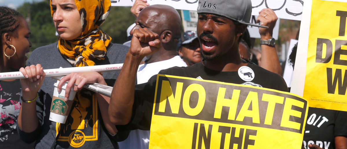 Protesters chant anti-Trump slogans during a protest against a visit by U.S. Republican candidate Donald Trump to an African-American church in Detroit, Michigan September 3, 2016. (Photo: REUTERS/Rebecca Cook