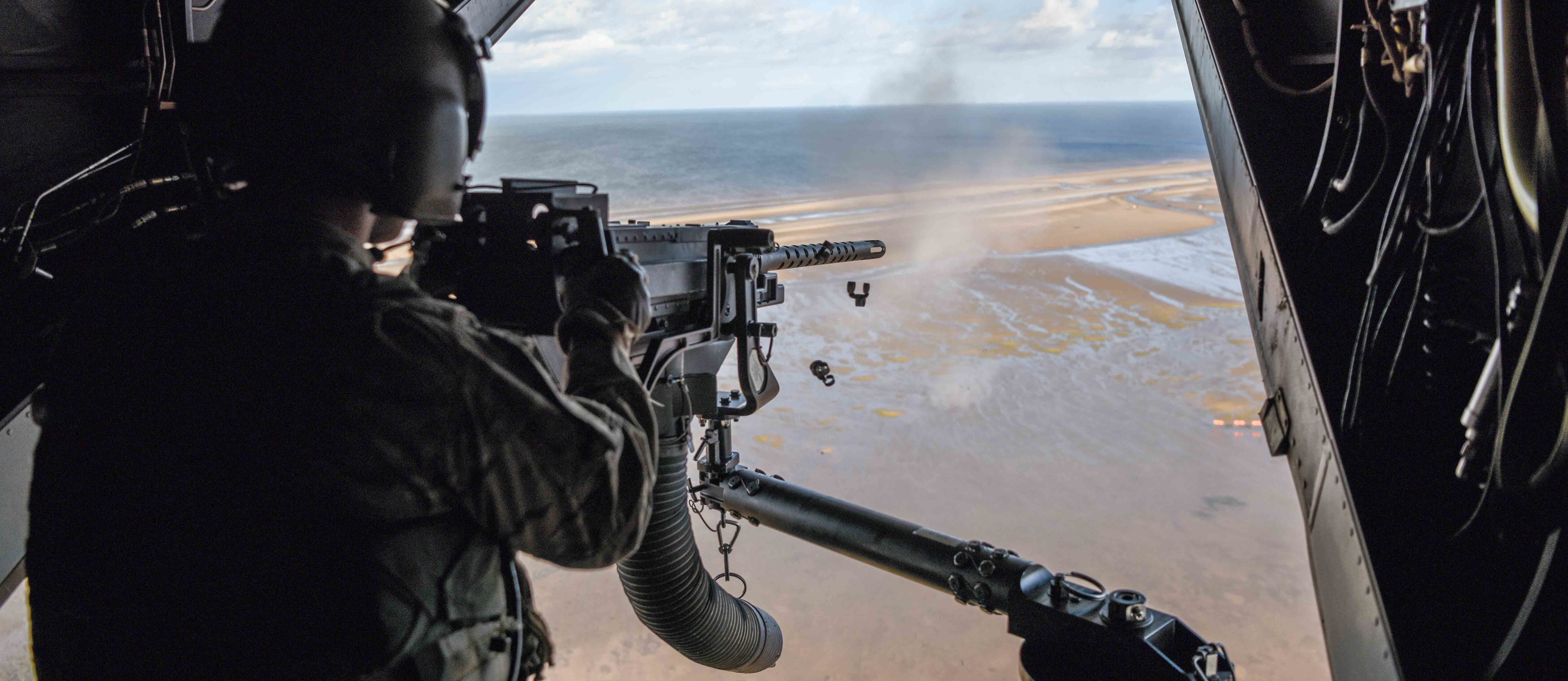 An Air Commando from the 7th Special Operations Squadron, 352d Special Operations Wing fires a .50 caliber machine gun aboard a CV-22 Osprey during a flight around southern England in September 2017. (U.S. Air Force photo by Staff Sgt. Philip Steiner)