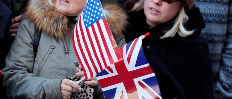 People hold U.S. and British flags as they wait for Britain's Prince Harry and his fiancee Meghan Markle to attend an event in Nottingham, December 1, 2017. REUTERS/Eddie Keogh
