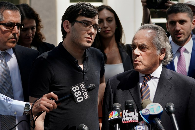 Former drug company executive Martin Shkreli stands with his attorney Benjamin Brafman after exiting U.S. District Court upon being convicted of securities fraud, in the Brooklyn borough of New York City, U.S., August 4, 2017. REUTERS/Carlo Allegri/File Photo