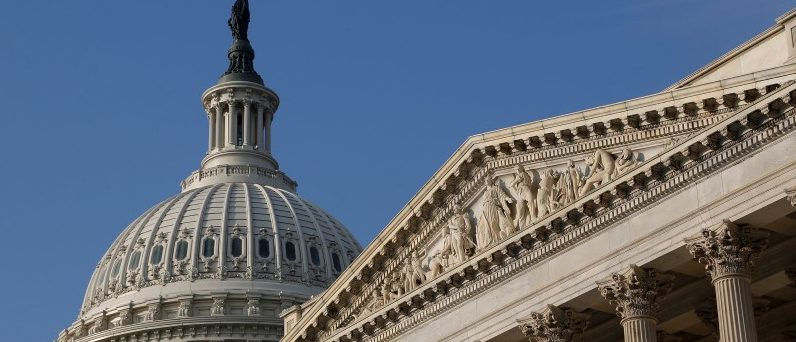 FILE PHOTO: The U.S. Capitol Dome (L) building is pictured in Washington, DC, U.S. on October 4, 2013.  REUTERS/Jonathan Ernst/File Photo