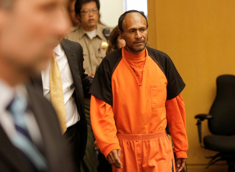 FILE PHOTO: Jose Ines Garcia Zarate, arrested in connection with the July 1, 2015, shooting of Kate Steinle on a pier in San Francisco is led into the Hall of Justice for his arraignment in San Francisco, California, U.S. on July 7, 2015. REUTERS/Michael Macor/Pool/File Photo
