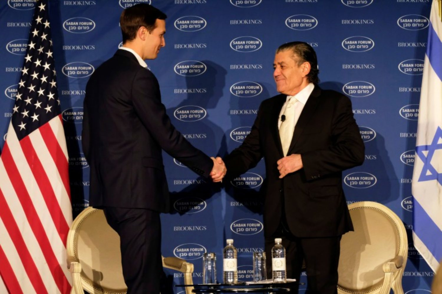 White House senior adviser Jared Kushner, shakes hands with Haim Saban, before discussing the Trump administration's approach to the Middle East region at the Saban Forum in Washington, U.S., December 3, 2017. REUTERS/James Lawler Duggan