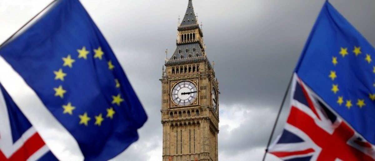 Union Flags and European Union flags fly near the Elizabeth Tower, housing the Big Ben bell, during the anti-Brexit 'People's March for Europe', in Parliament Square in central London, Britain September 9, 2017. REUTERS/Tolga Akmen/File Photo