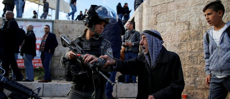 A Palestinian man argues with an Israeli border policewoman during a protest following U.S. President Donald Trump's announcement that he has recognized Jerusalem as Israel's capital, near Damascus Gate in Jerusalem's Old City December 7, 2017. REUTERS/Ammar Awad