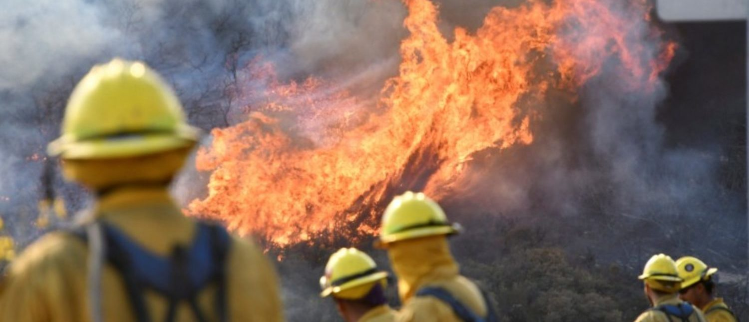 Fire fighters attack the Thomas Fire's north flank with backfires as they continue to fight a massive wildfire north of Los Angeles, near Ojai , California, U.S., December 9, 2017. REUTERS/Gene Blevins