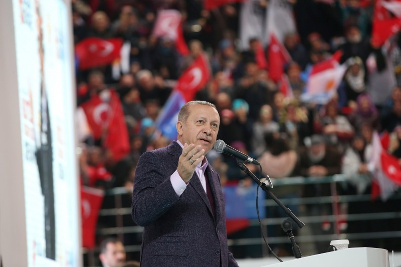 Turkish President Erdogan addresses his supporters during a meeting of his ruling AK Party in Sivas