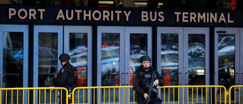 Police officers stand guard outside the New York Port Authority Bus Terminal in New York City, U.S. December 11, 2017 after reports of an explosion. REUTERS/Lucas Jackson