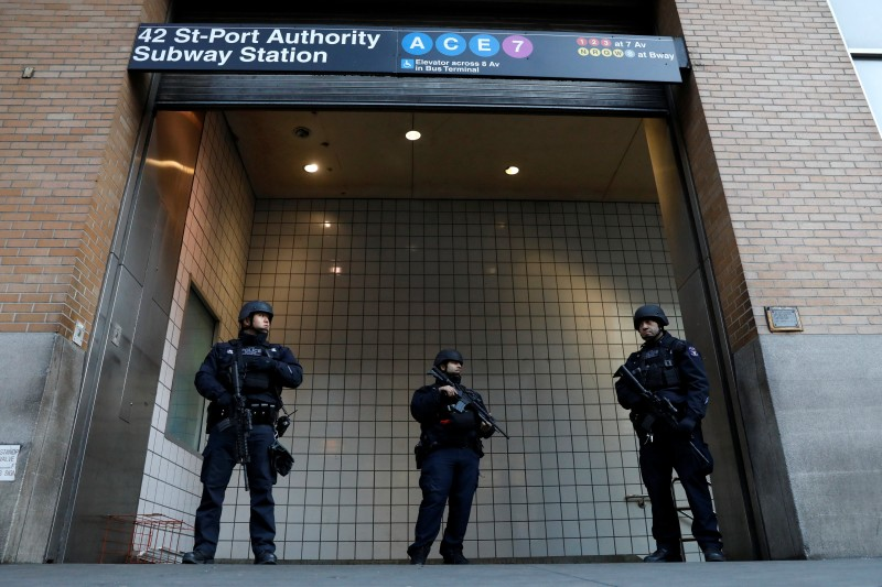 Police officers stand guard outside the closed New York Port Authority Subway entrance following an reported explosion, in New York City, U.S. December 11, 2017. REUTERS/Brendan McDermid