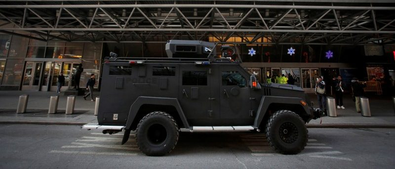 An armored vehicle belonging to the New York Port Authority sits beneath a Christmas decoration at the entrance of the New York Port Authority Bus Terminal following an attempted detonation during the morning rush hour, in New York City, New York, U.S., December 11, 2017.  REUTERS/Andrew Kelly