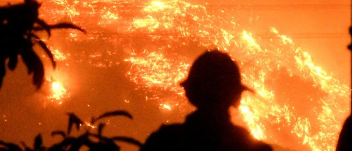 Firefighters keep a close watch on the Thomas wildfire in the hills outside Montecito, California