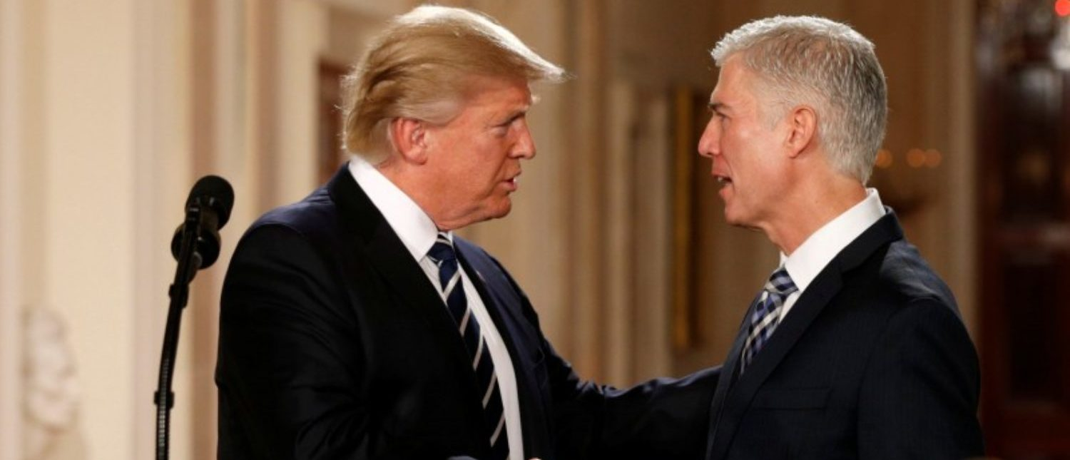 FILE PHOTO: U.S. President Donald Trump shakes hands with Neil Gorsuch (R) after nominating him to be an associate justice of the U.S. Supreme Court at the White House in Washington, D.C., U.S. on January 31, 2017. REUTERS/Kevin Lamarque/File Photo