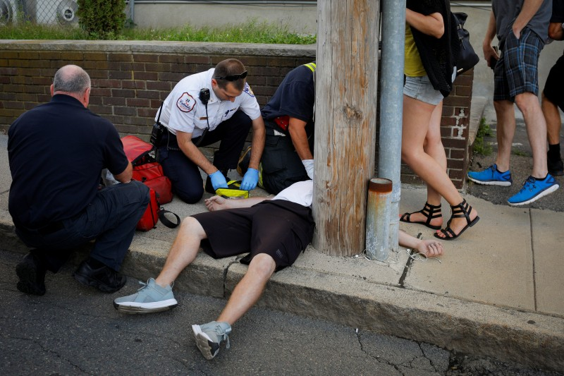Cataldo Ambulance medics and other first responders revive a 32-year-old man who was found unresponsive and not breathing after an opioid overdose on a sidewalk in the Boston suburb of Everett, Massachusetts, U.S., August 23, 2017. REUTERS/Brian Snyder