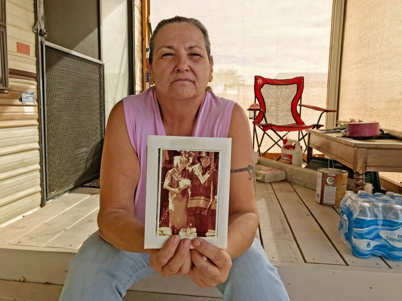 Tama DeRosier, 58, shows a photo of her husband Robert, at her mobile home in Mohave Valley