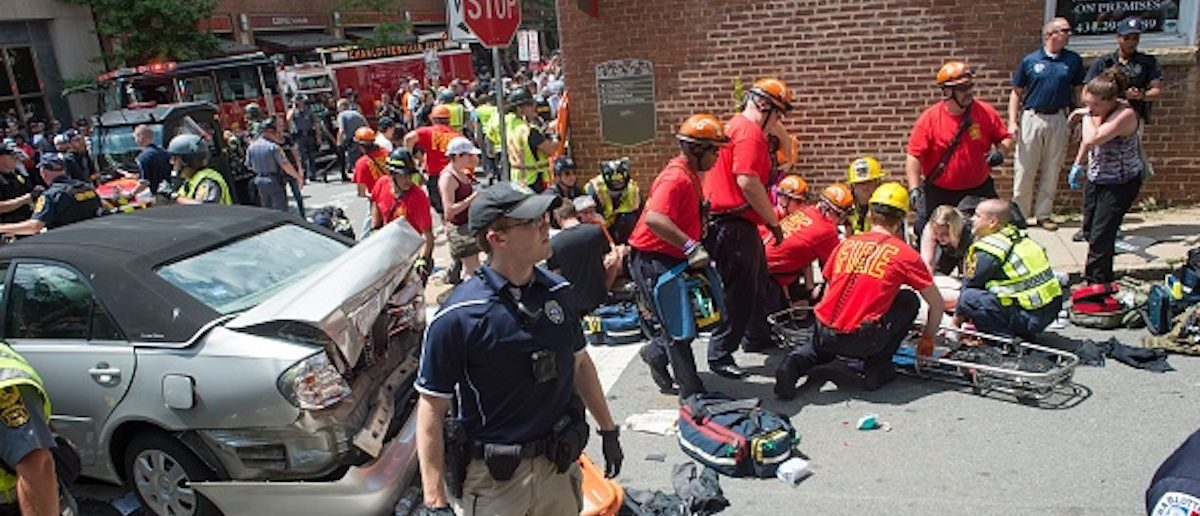 A woman is received first-aid after a car accident ran into a crowd of protesters in Charlottesville, VA on August 12, 2017. (Photo: PAUL J. RICHARDS/AFP/Getty Images)