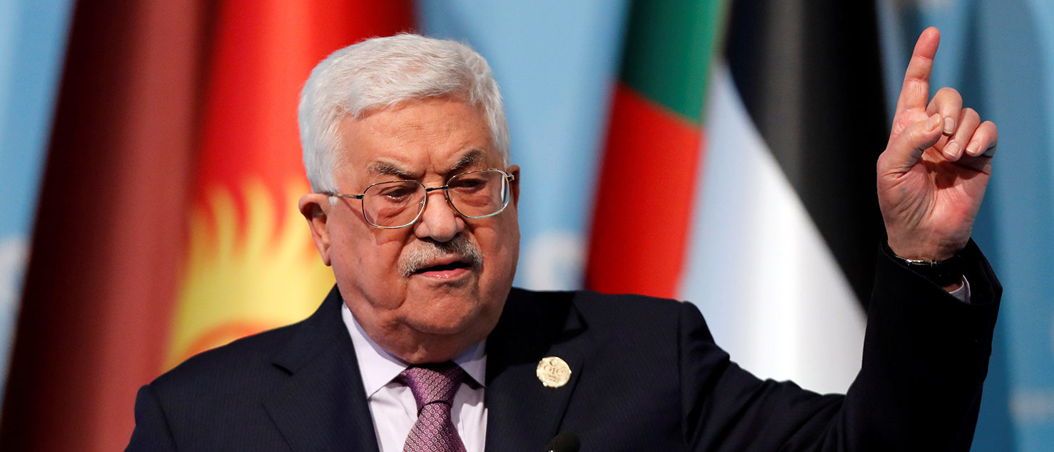 Palestinian President Mahmoud Abbas speaks during a news conference following the extraordinary meeting of the Organisation of Islamic Cooperation (OIC) in Istanbul, Turkey, December 13, 2017. REUTERS/Osman Orsal