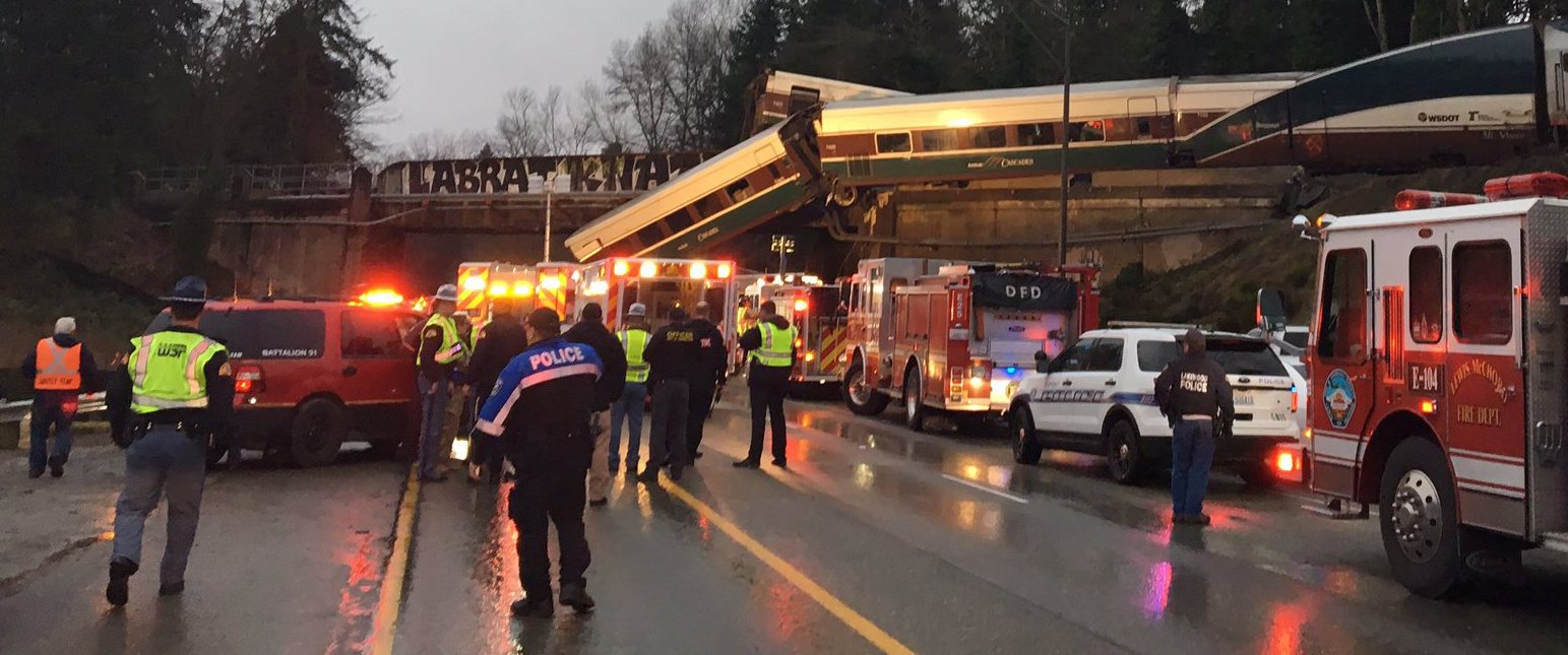 First responders are seen at the scene of an Amtrak passenger train derailment on interstate highway (I-5) in this Washington State Patrol image moved on social media in DuPont, Washington, U.S., December 18, 2017. (Photo: Brooke Bova/Washington State Patrol/Handout via REUTERS)