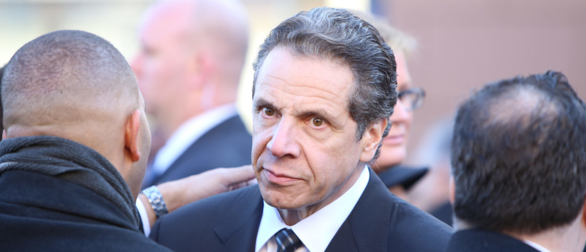 Andrew Cuomo attending funeral services for NYPD officer Rafael Ramos. (Photo: ShutterStock/A Katz)
