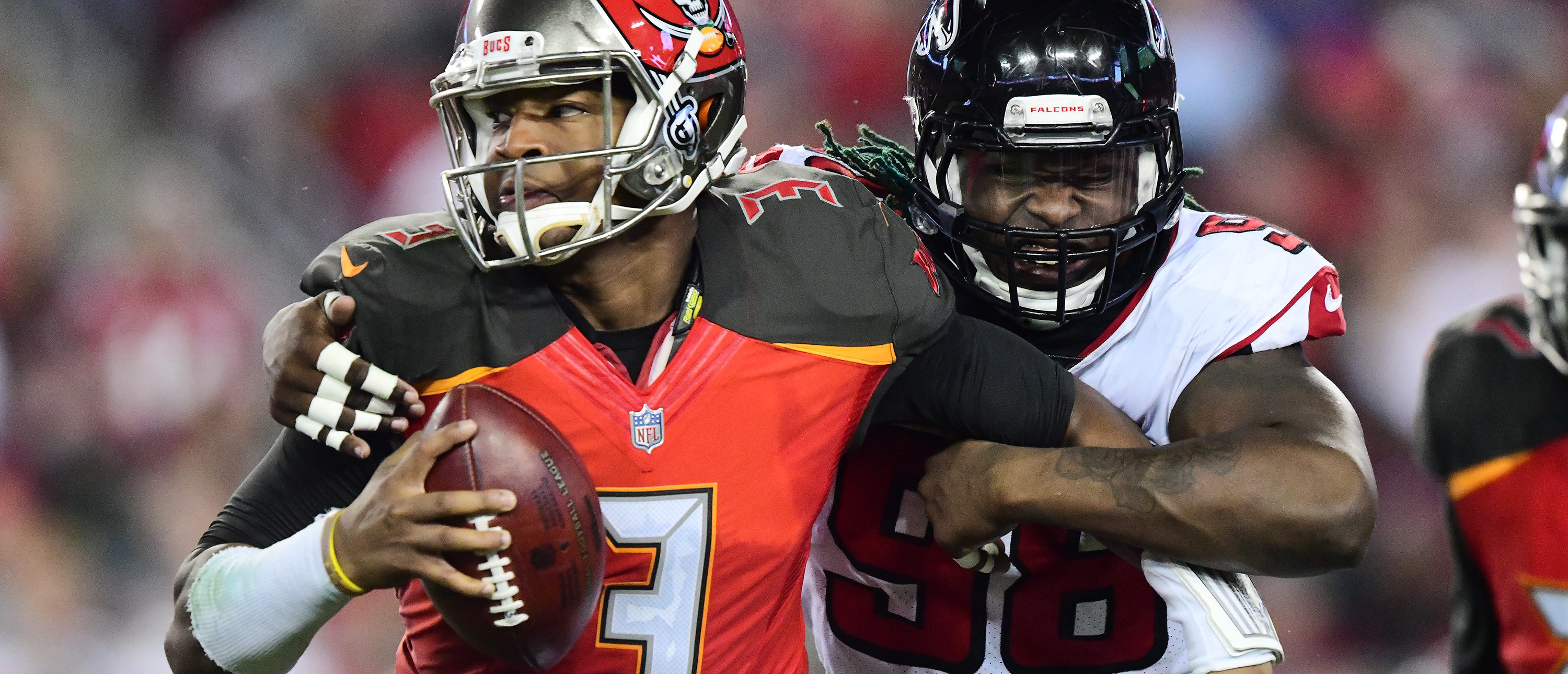 TAMPA, FL - DECEMBER 18: Defensive end Takkarist McKinley #98 of the Atlanta Falcons wraps up quarterback Jameis Winston #3 of the Tampa Bay Buccaneers to cause a fumble in the second quarter on December 18, 2017 at Raymond James Stadium in Tampa, Florida. (Photo by Julio Aguilar/Getty Images)