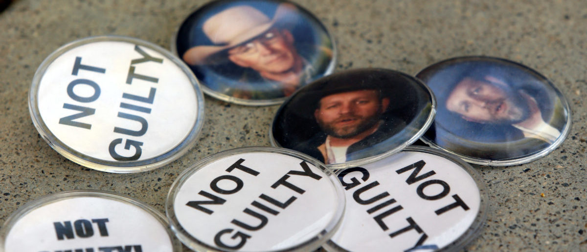 Buttons with images of Cliven Bundy's son Ammon Bundy and slain Arizona rancher LaVoy Finicum, are shown outside the federal courthouse in Las Vegas