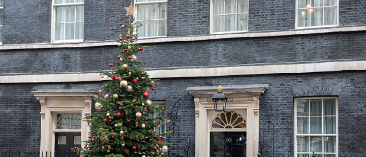 A Christmas tree and decorations are seen outside No. 10 of Downing Street, London on December 4, 2017. (Photo by Alberto Pezzali/NurPhoto via Getty Images)