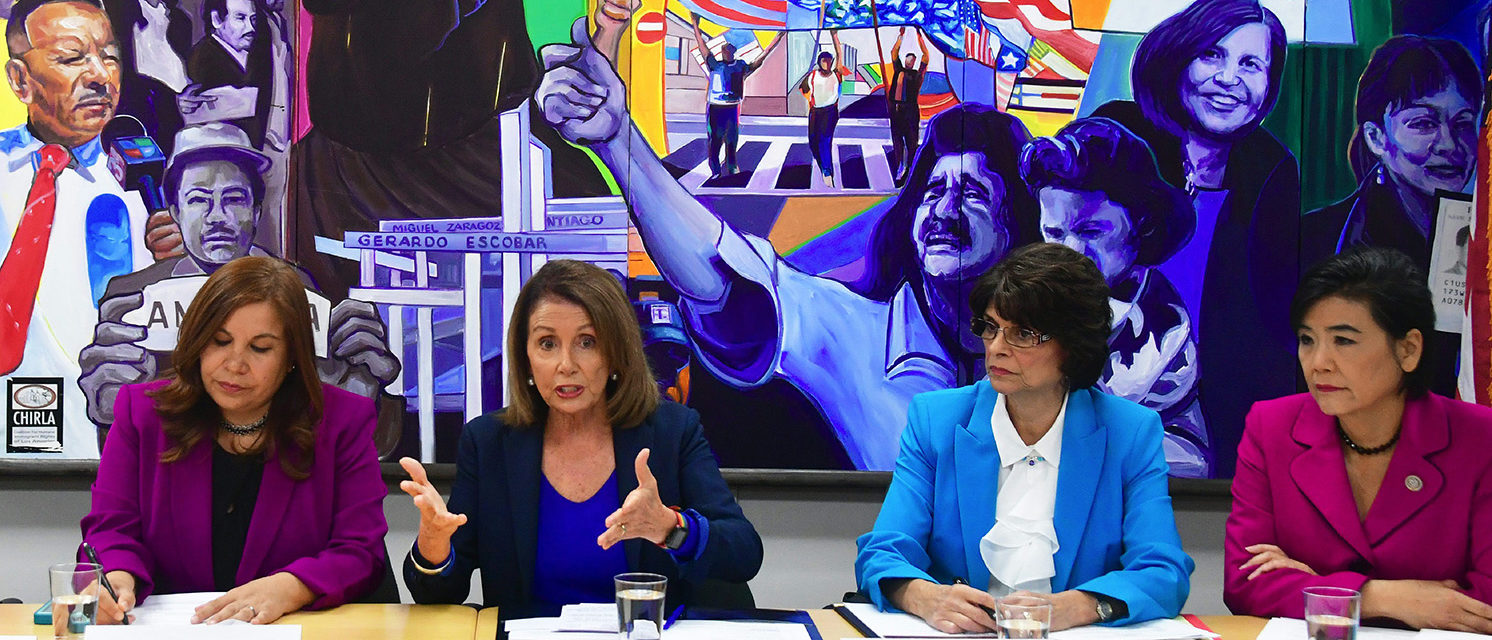 House Democratic Leader Nancy Pelosi (2L) gestures while speaking with young immigrants protected by DACA and community leaders as Angelica Salas, CHIRLA Executive Director (L), (Photo: FREDERIC J. BROWN/AFP/Getty Images)