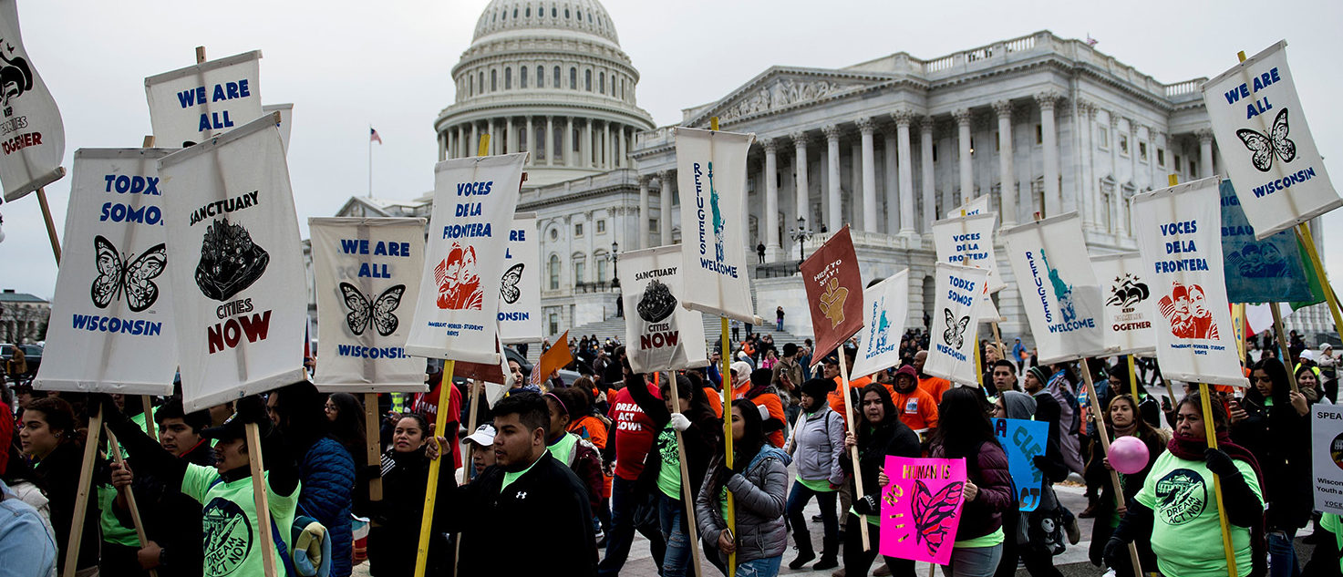 People protesting the cancellation of the Deferred Action for Childhood Arrivals rally outside the Capitol Building on Capitol Hill December 6, 2017 in Washington, DC. BRENDAN SMIALOWSKI/AFP/Getty Images