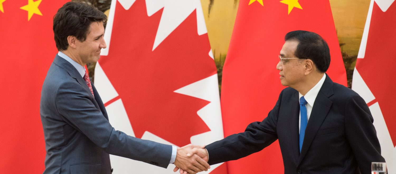 Canadian Prime Minister Justin Trudeau and Chinese Premier Li Keqiang shake hands during a news conference meeting at the Great Hall of the People in Beijing, China December 4, 2017. REUTERS/Fred Dufour/Pool
