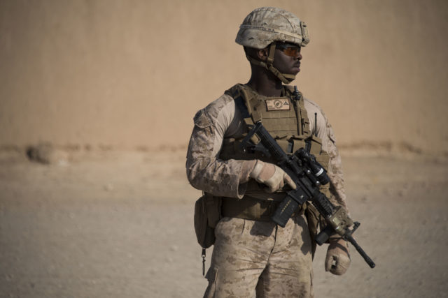 Lance Cpl. Martin serves during a visit to the Regional Military Training Center in Helmand Province. (Hailey Sadler)