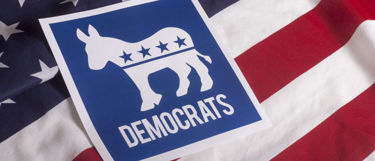 A Democratic symbol is on a textured American flag. (Photo: ShutterStock/Danielfela)
