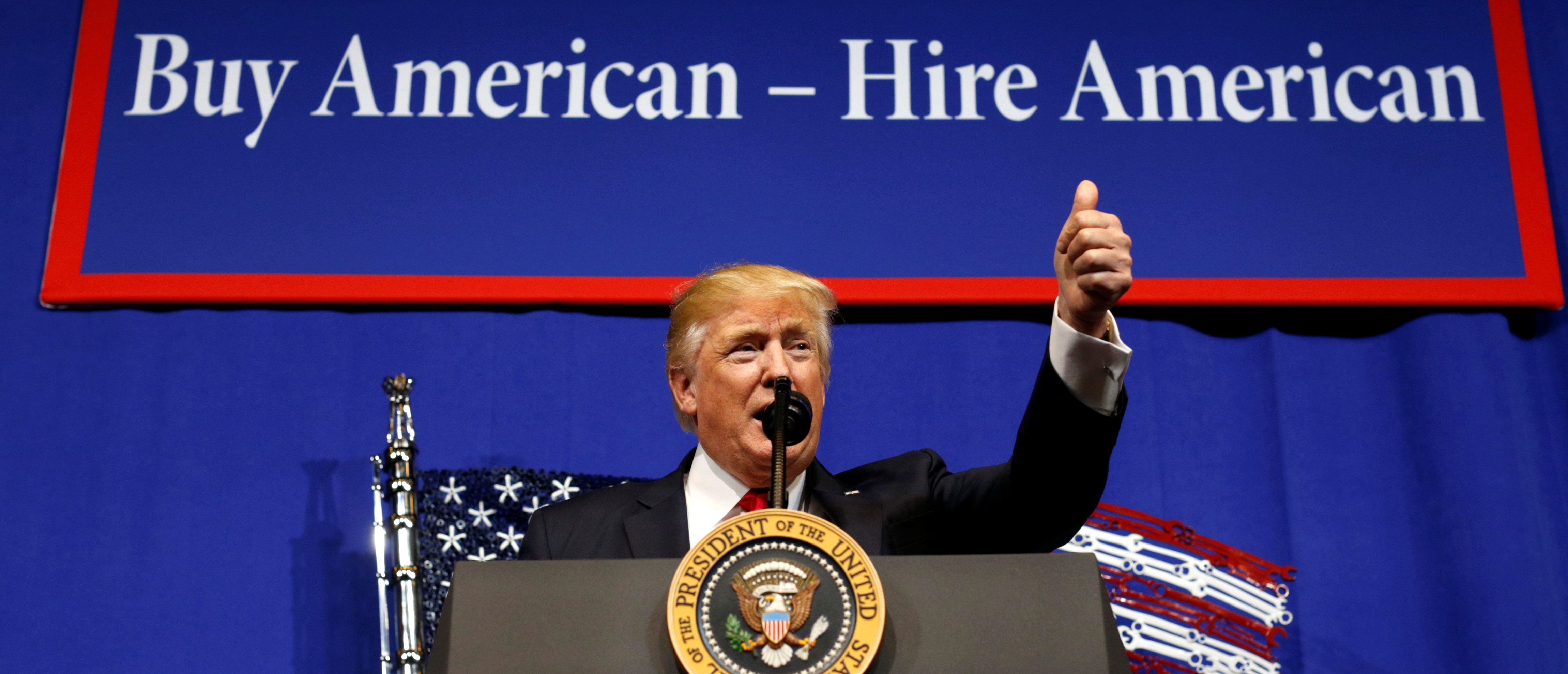 President Donald Trump speaks before signing an executive order directing federal agencies to recommend changes to a temporary visa program used to bring foreign workers to the United States to fill high-skilled jobs during a visit to the world headquarters of Snap-On Inc, a tool manufacturer, in Kenosha, Wisconsin, April 18, 2017. REUTERS/Kevin Lamarque