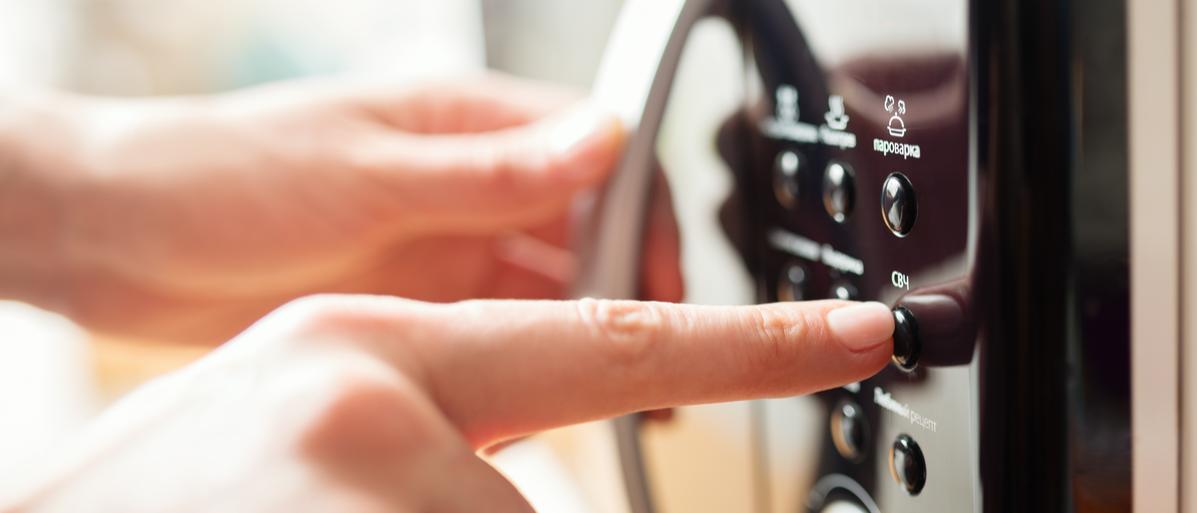 Using microwave oven, close up photo, shallow dof Shutterstock/ Kostenko Maxim