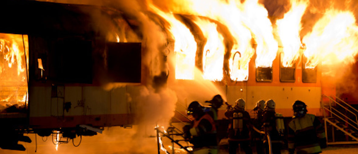 Fire fighters extinguishing the fire on a train - some motion blur Photo Credit: Getty Images