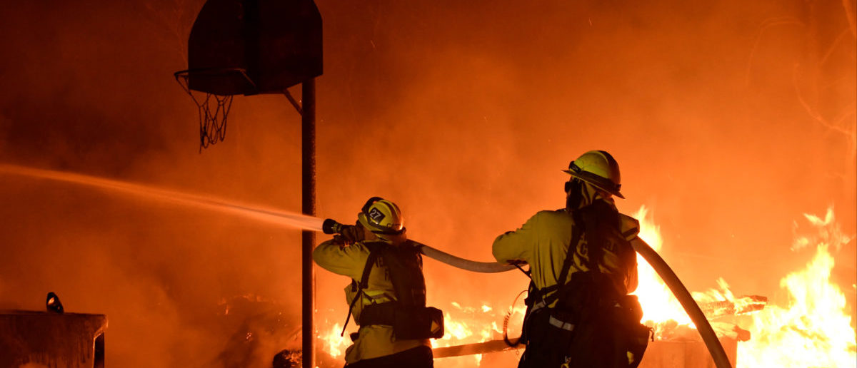 Firefighters battle flames from a Santa Ana wind-driven brush fire called the Thomas Fire in Santa Paula, California, December 4, 2017. Photo taken December 4, 2017. REUTERS/Gene Blevins