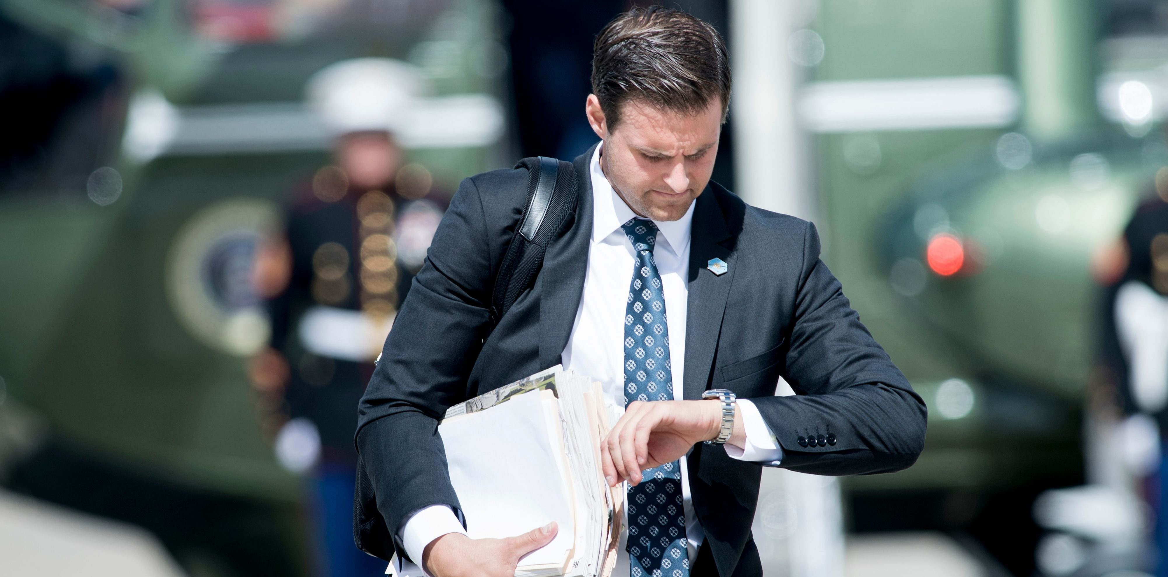 John McEntee, special assistant and personal aide follows US President Donald Trump to Air Force One at Andrews Air Force Base September 27, 2017 in Maryland. / AFP PHOTO / Brendan Smialowski (Photo credit should read BRENDAN SMIALOWSKI/AFP/Getty Images)