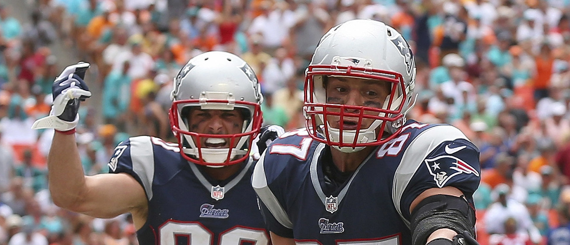 MIAMI GARDENS, FL - SEPTEMBER 07:  Rob Gronkowski #87 of the New England Patriots celebrates his second quarter touchdown on a pass from Tom Brady #12 as teammate Danny Amendola #80 looks on during a game against the Miami Dolphins at Sun Life Stadium on September 7, 2014 in Miami Gardens, Florida.  (Photo by Mike Ehrmann/Getty Images)