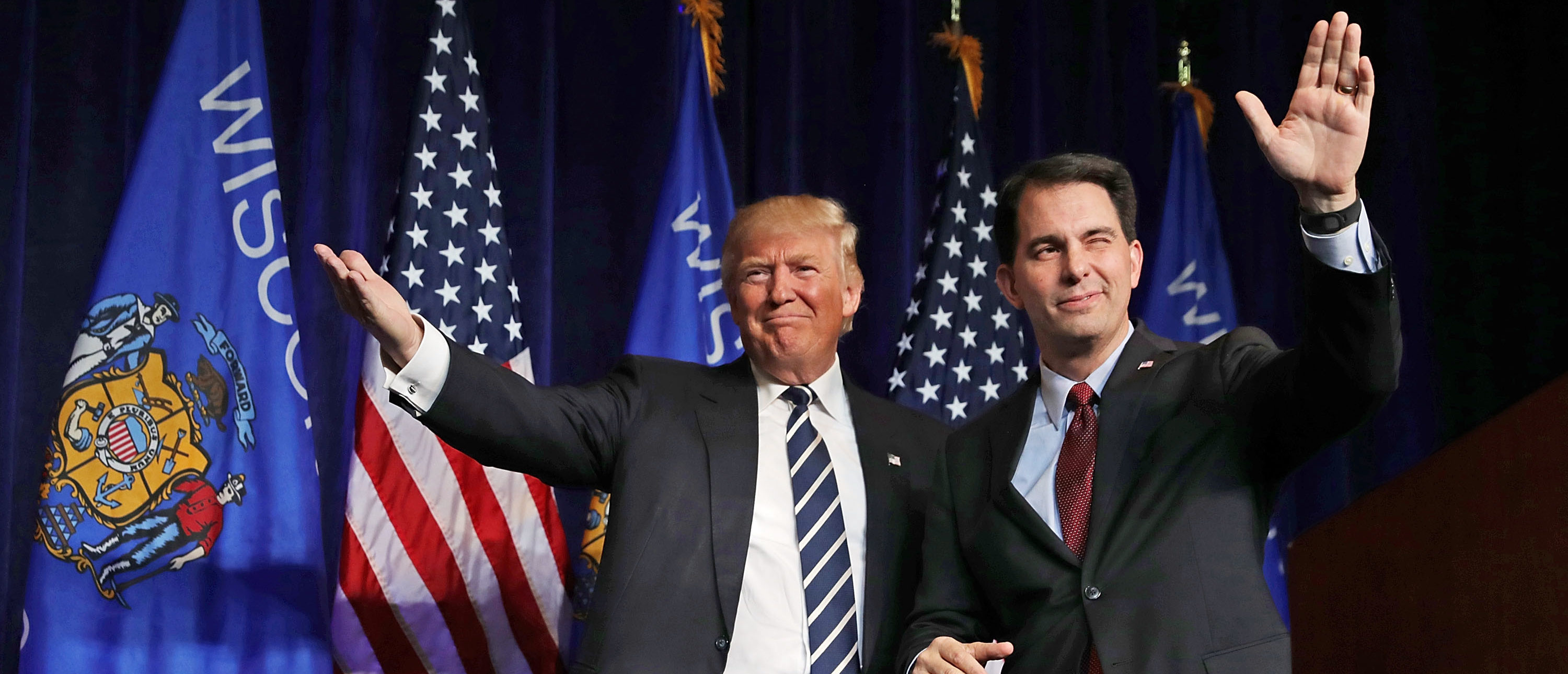 EAU CLAIRE, WI - NOVEMBER 01: Republican presidential nominee Donald Trump (L) is welcomed to the stage by Wisconsin Governor Scott Walker during a campaign rally at the W.L. Zorn Arena November 1, 2016 in Altoona, Wisconsin. Walker ran for the Republican nomination against Trump and eventually dropped out of the race for the presidency. (Photo by Chip Somodevilla/Getty Images)