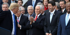 WASHINGTON, DC - DECEMBER 20: U.S. President Donald Trump (L) jokes with Senate Majority Leader Mitch McConnell (R-KY), Sen. Mike Enzi (R-WY), Vice President Mike Pence, Spaker of the House Paul Ryan (R-WI) and Sen. Tim Scott (R-SC) during an event celebrating the passage of the Tax Cuts and Jobs Act on the South Lawn of the White House December 20, 2017 in Washington, DC. The tax bill is the first major legislative victory for the GOP-controlled Congress and Trump since he took office almost one year ago. (Photo by Chip Somodevilla/Getty Images)
