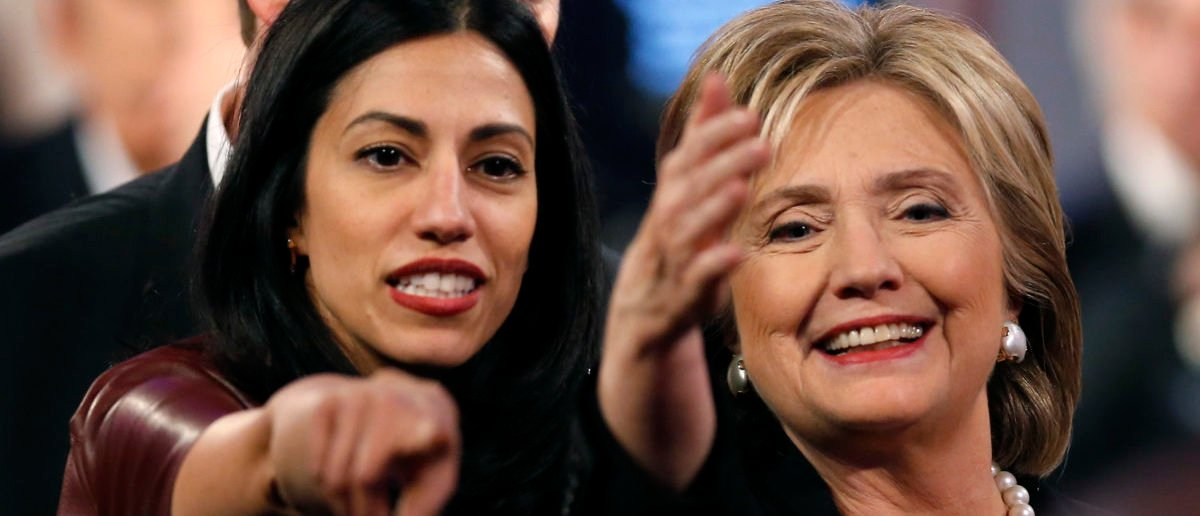 Huma Abedin, aide to Hillary Clinton, points as Mrs. Clinton waves in Des Moines, Iowa, November 14, 2015. REUTERS/Jim Young