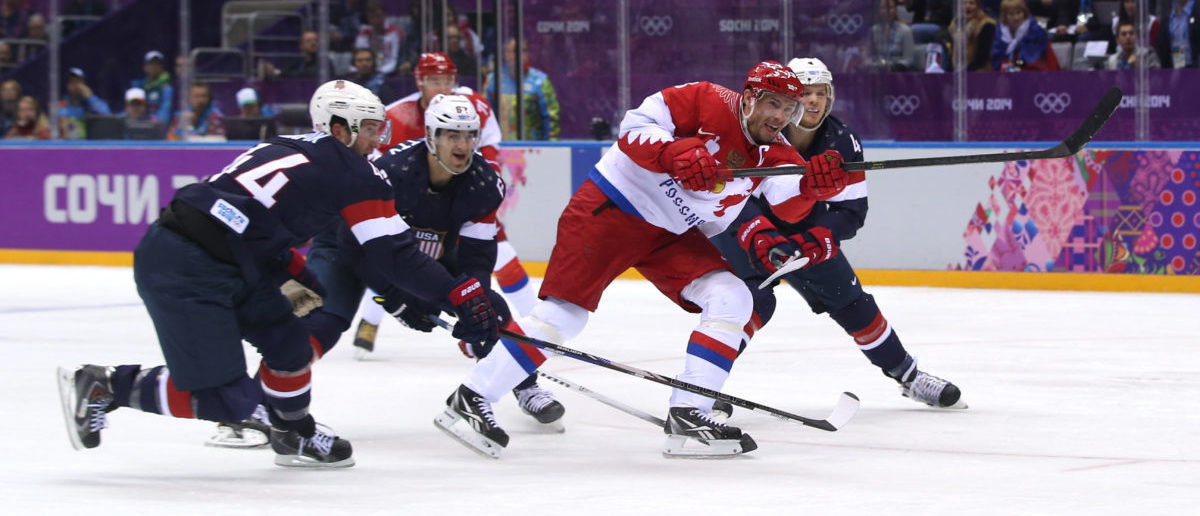 Pavel Datsyuk #13 of Russia scores a goal against the United States during the Men's Ice Hockey Preliminary Round Group A game on day eight of the Sochi 2014 Winter Olympics at Bolshoy Ice Dome on February 15, 2014 in Sochi, Russia.  (Photo by Bruce Bennett/Getty Images)