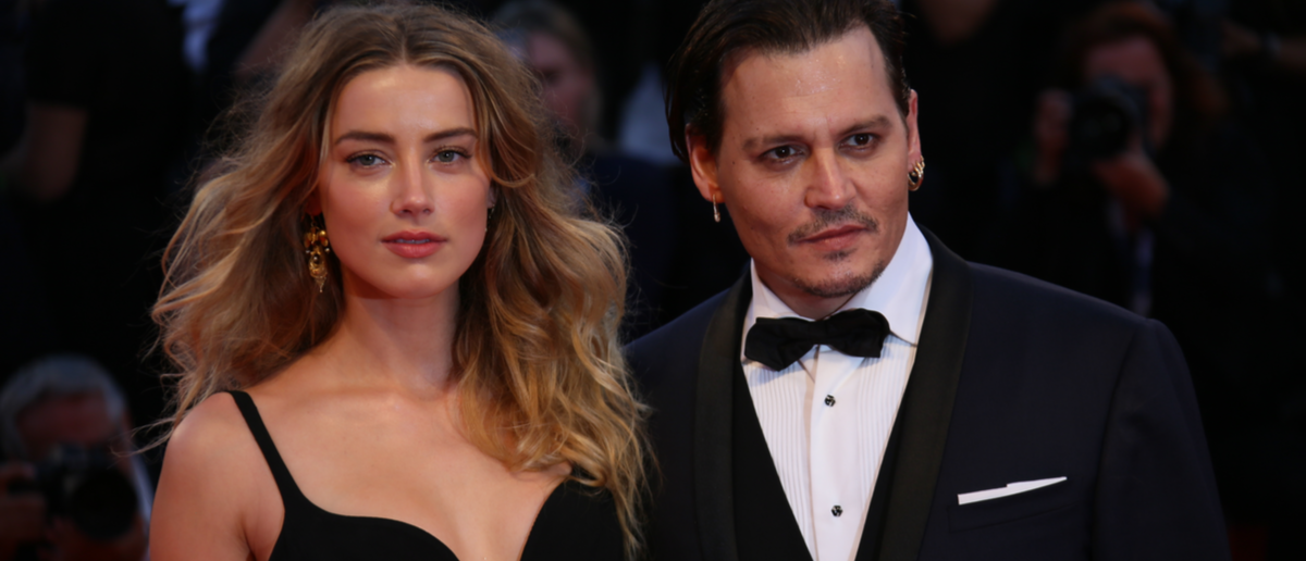Johnny Depp and Amber Heard attend the premiere of the movie 'BLACK MASS' during the 72nd Venice Film Festival on September 4, 2015 in Venice, Italy. Shutterstock/ Denis Makarenko