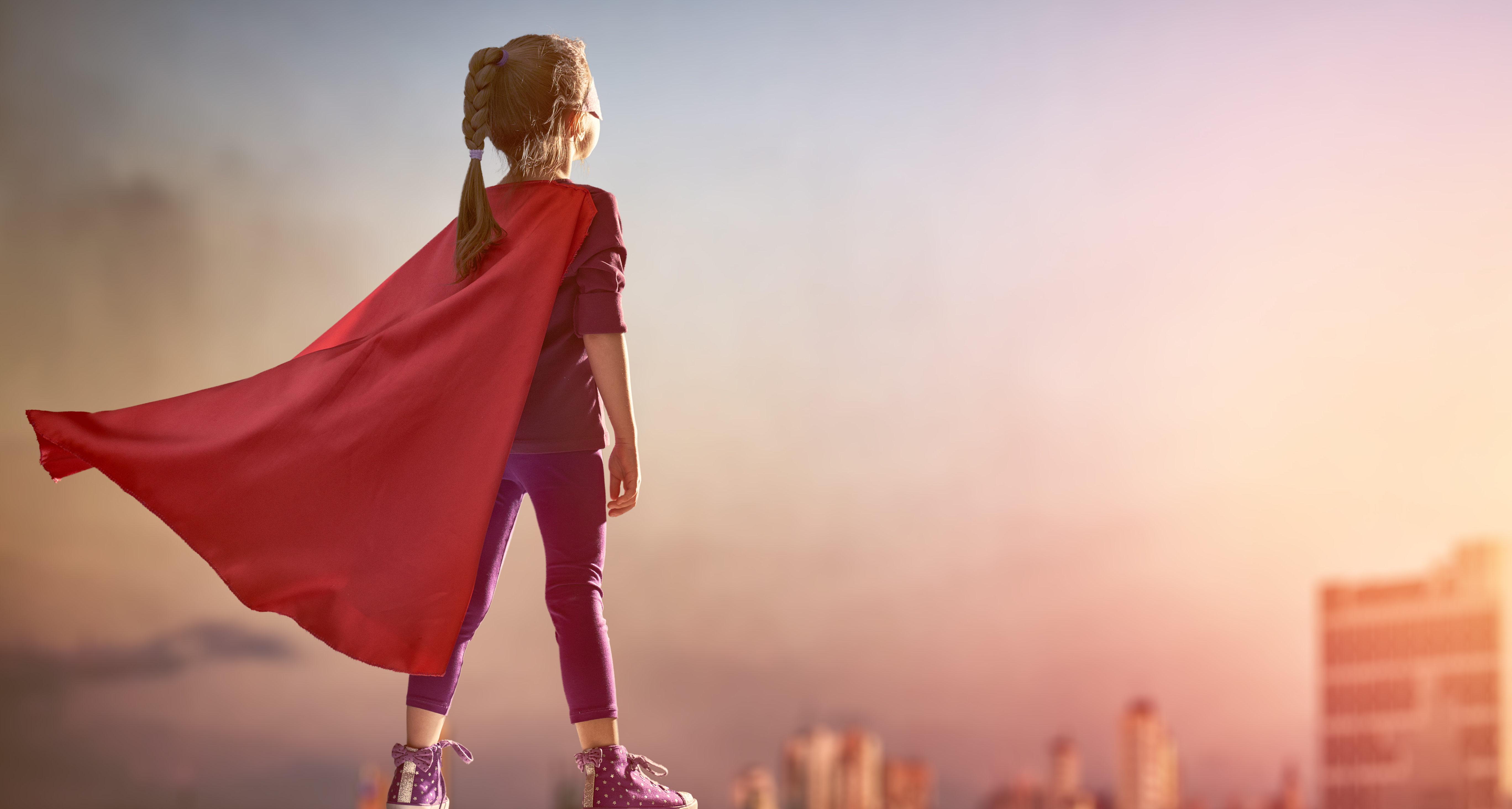 A little girl plays a superhero. (Photo: Shutterstock/Yuganov Konstantin)