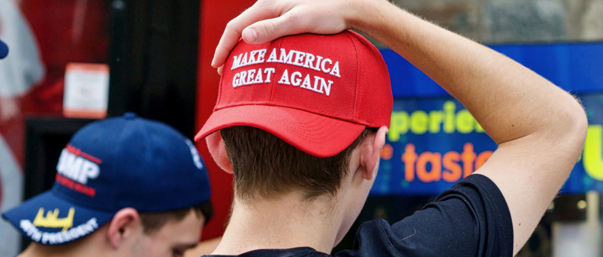 Two unidentified men display their support for President Donald J. Trump through the hats they are wearing during a visit to the National Zoo. (Shutterstock/John M. Chase)