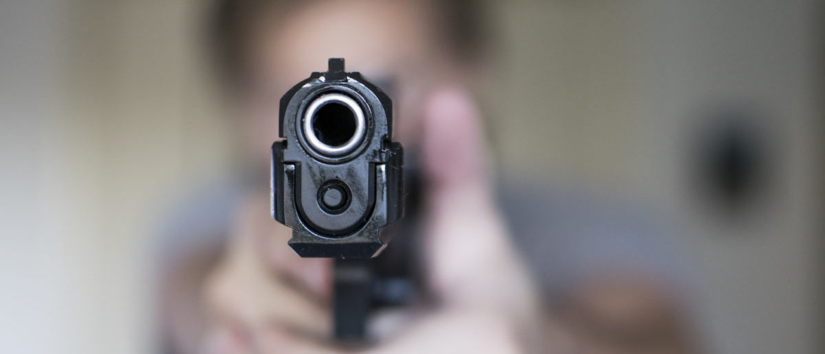 Man holding gun in self defense