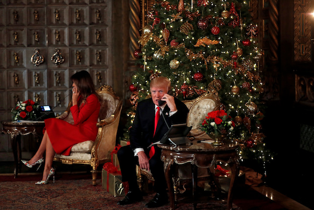 U.S. President Donald Trump and First Lady Melania Trump participate in NORAD (North American Aerospace Defense Command) Santa Tracker phone calls with children at Mar-a-Lago estate in Palm Beach, Florida, U.S., December 24, 2017. REUTERS/Carlos Barria TPX IMAGES OF THE DAY - RC139CE8FF80