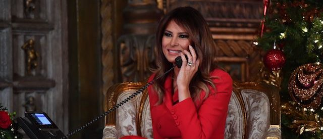First Lady Melania Trump participates in NORAD Santa Tracker phone calls at the Mar-a-Lago resort in Palm Beach, Florida on December 24, 2017. 