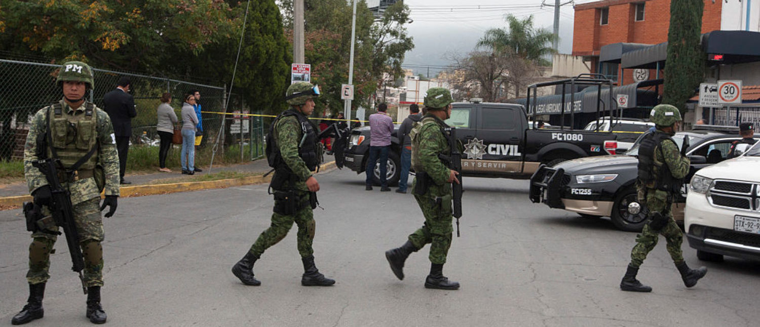Members of the Mexican Army are deployed outside a high school where a student opened fire on his classmates in Monterrey, Mexico, on January 18, 2017. A high school student shot his teammates at a college in Monterrey, an industrial city in northeastern Mexico, in an unprecedented event that left five people injured, including the assailant who attempted suicide, authorities in the state of Nuevo Leon reported. (Photo: JULIO CESAR AGUILAR/AFP/Getty Images)