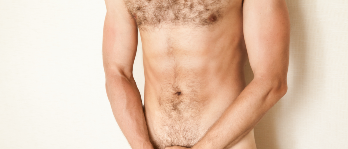 A naked Caucasian man covers his genitals with his hands. (Photo: Shutterstock/ Violetstudio)
