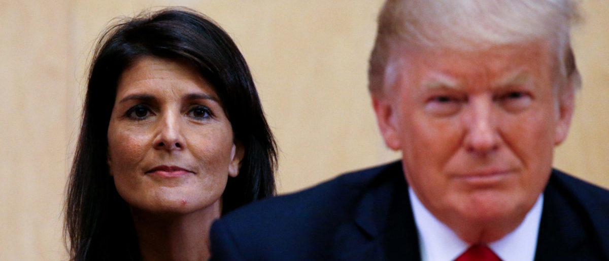FILE PHOTO: U.S. Ambassador to the UN Nikki Haley (L) and U.S. President Donald Trump participate in a session on reforming the United Nations at UN Headquarters in New York, U.S., September 18, 2017. REUTERS/Kevin Lamarque